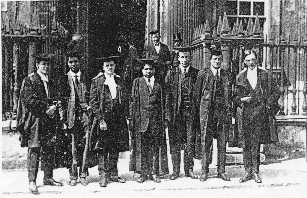 Ramanujan (centre) with other graduates at Trinity College in March 1916.